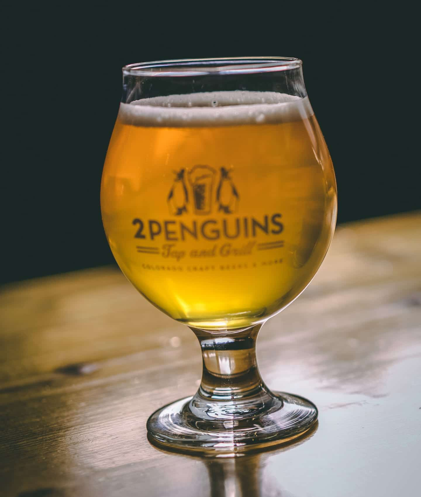 Two Penguins Tap & Grill Centennial Beer Glass