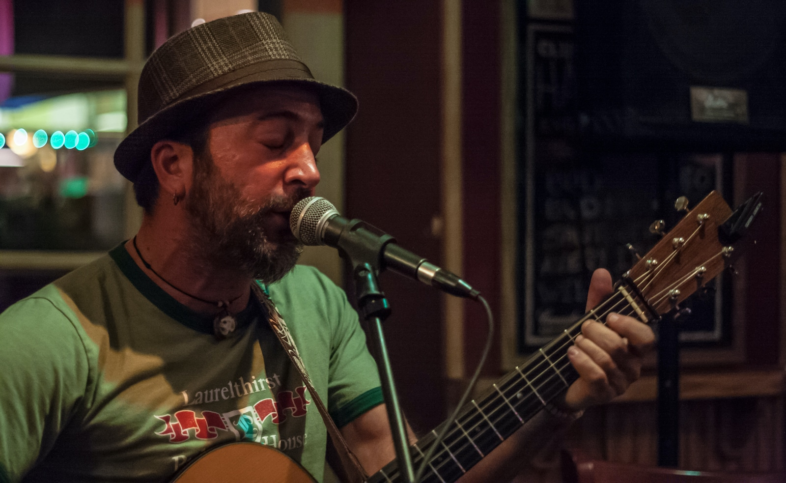 Pearl Street Pub and Cellar Singer on Microphone Boulder CO