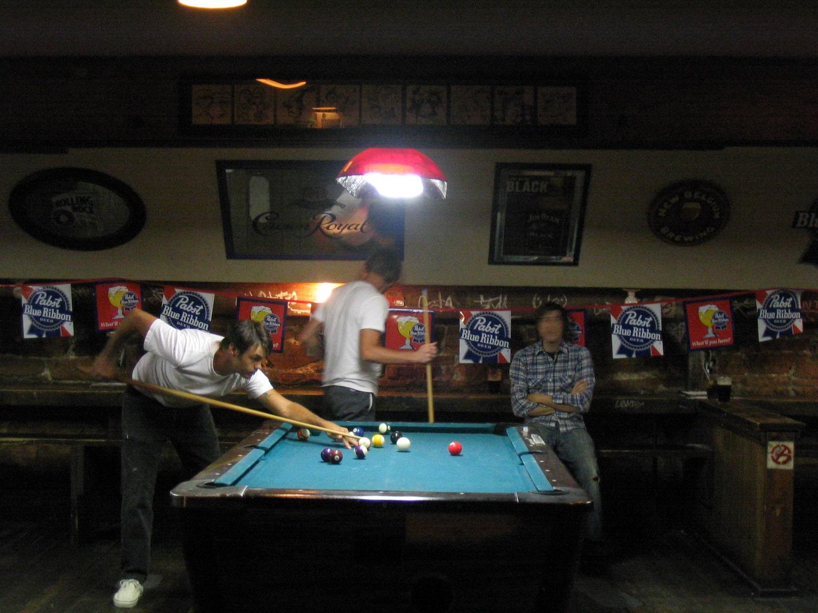 Sun Down Saloon Guys playing pool boulder co